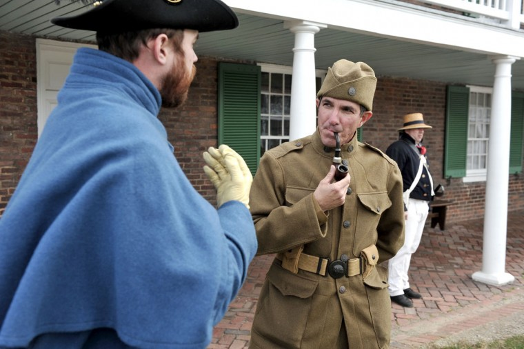 November 11, 2011: Rangers Jim Bailey (L), dressed as a Union Civil War soldier, and Tim Ertel (C), wearing the uniform of a WWI corpsman, talk as Mark Smith (R), a volunteer representing soldiers in the War of 1812 stands by. They are participants in living history for the Veteran's Day weekend at Ft. McHenry National Monument and Historic Shrine. (Kim Hairston/Baltimore Sun)