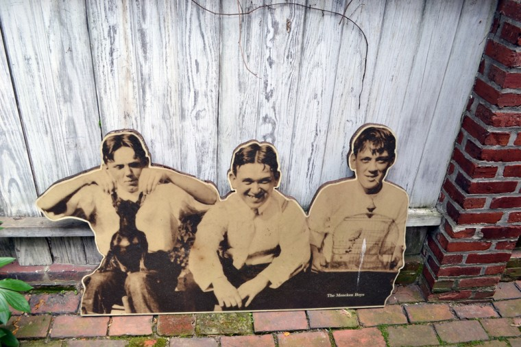 A photo of the Mencken Brothers is displayed in the backyard of the H.L. Mencken house. (Steve Earley/Baltimore Sun)