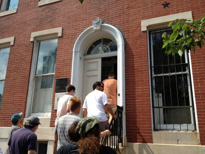 Photographers enter a row house that belonged to famed Sun journalist H.L. Mencken. (Olivia Hubert-Allen/Baltimore Sun)
