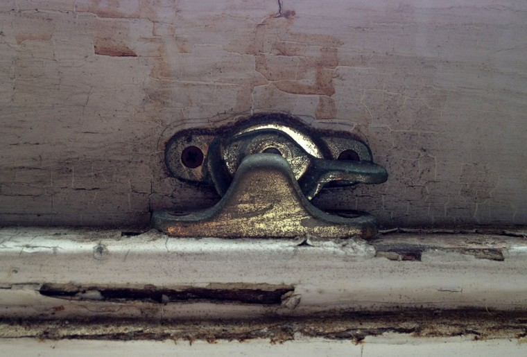 A window latch inside the home of H.L. Mencken. (Olivia Hubert-Allen/Baltimore Sun)