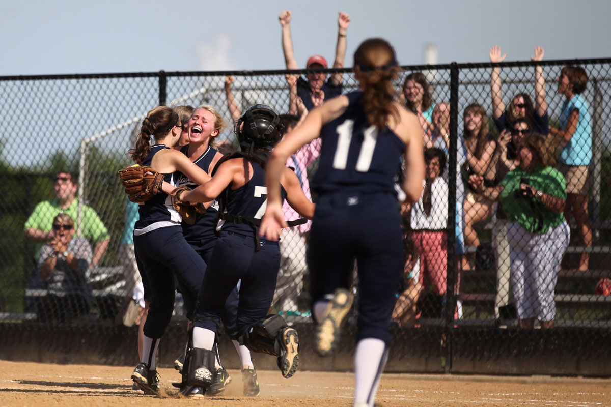 "Notre Dame softball players run to their teammate Emily Reuling after Rueling caught the last out of the ""B"" conference girls softball championship game against The Catholic at Bachman Sports Complex in Glen Burnie on Thursday, May 17, 2012. (Jen Rynda/Patuxent Homestead)"