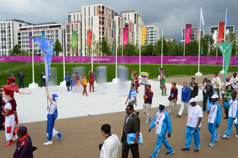 Members of the Somali (Below R) and Colombian delegations take part in a welcoming ceremony for athletes at the London 2012 Olympic Village at the Olympic Park in east London, on July 20, 2012. (Miguel Medina/AFP/Getty Images)
