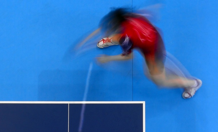 A picture taken with a robotic camera shows Ariel Hsing of the US returning to Mexico's Yadira Silva (unseen) during their women's first round table tennis match at London 2012 Olympic Games on July 28, 2012 in London. (Antonin Thuillier/AFP/Getty Images)