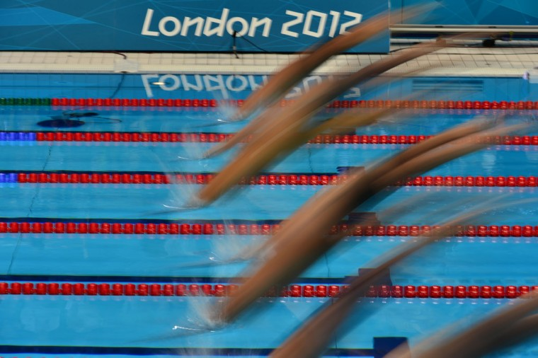 Athletes compete in the men's 200m freestyle semi-final swimming event at the London 2012 Olympic Games on July 29, 2012 in London. (Gabriel Bouys/AFP/Getty Images)