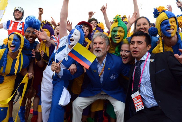 Members of the Colombian delegation (C and R) are welcomed by members of the National Youth Theatre of Great Britain during a Welcoming Ceremony for athletes and delegates at the London 2012 Olympic Village in the Olympic Park in east London, on July 20, 2012.( Miguel Medina/AFP/Getty Images)