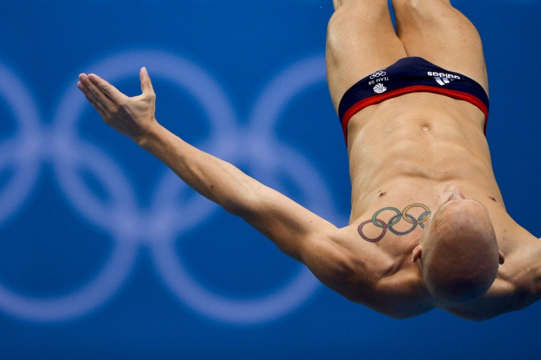 British athlete Nicholas Robinson Baker's tattoo is seen as he dives during a training session at the Aquatics Center in London on July 26, 2012 on the eve of the official opening of the 2012 London Olympic Games. (Fabrice Coffrini/AFP/Getty Images)
