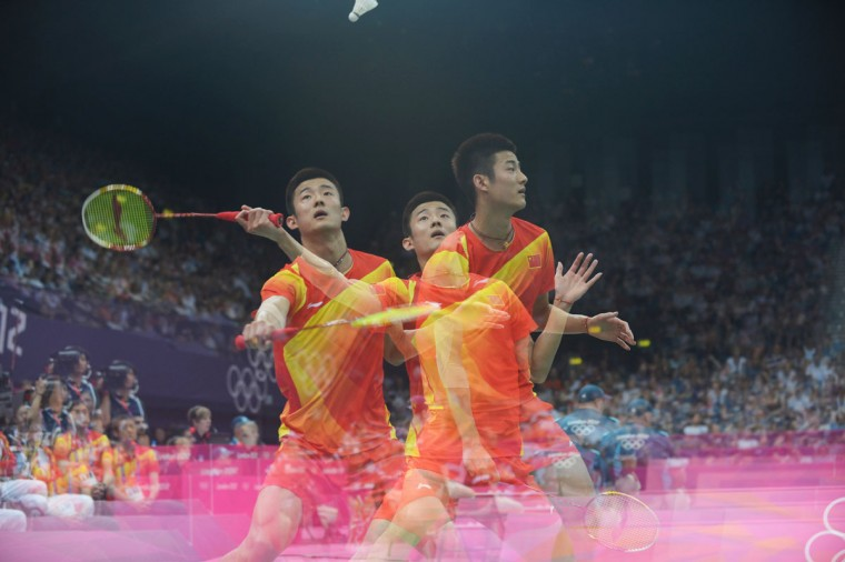 This multiple exposure photo shows China's Chen Long returns a shot to Thailand's Boonsak Ponsana in the men's singles badminton match during the London 2012 Olympic Games on July 29, 2012 in London. Chen won 21-12, 21-17. (Adek Berry/AFP/Getty Images)