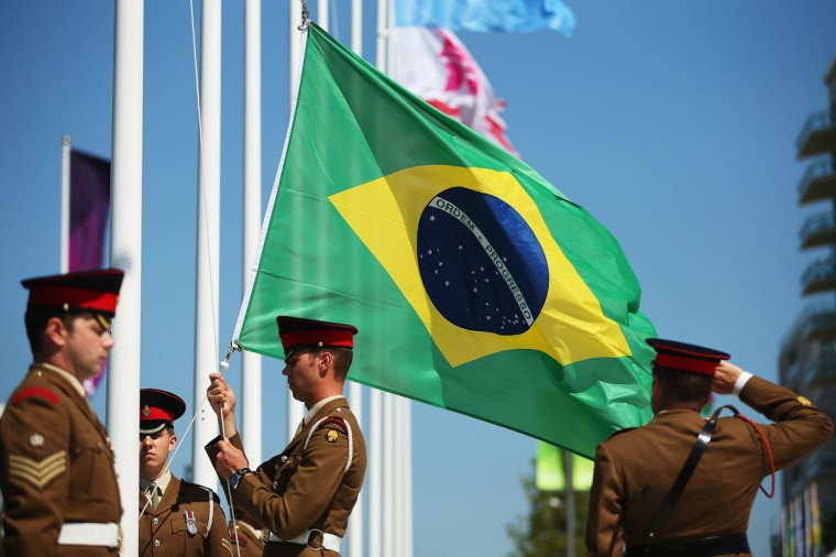 The flag of Brazil is released during a Welcoming Ceremony in the Athletes Village during previews ahead of the London Olympic Games on July 23, 2012 in London, England. (Hannah Johnston/Getty Images)