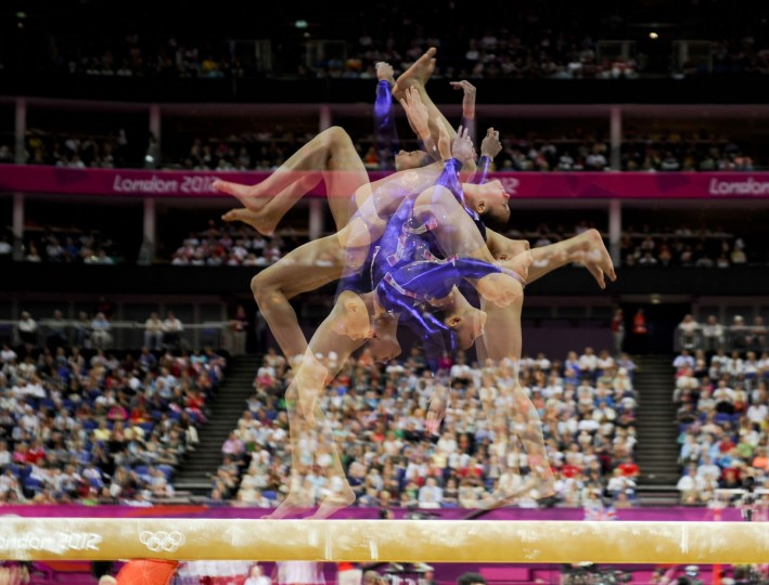 Kyla Ross (USA) competes on the beam during the women's competition during the London 2012 Olympic Games at North Greenwich Arena. Multiple exposures were combined in camera to produce this image. (Robert Deutsch/USA TODAY Sports)