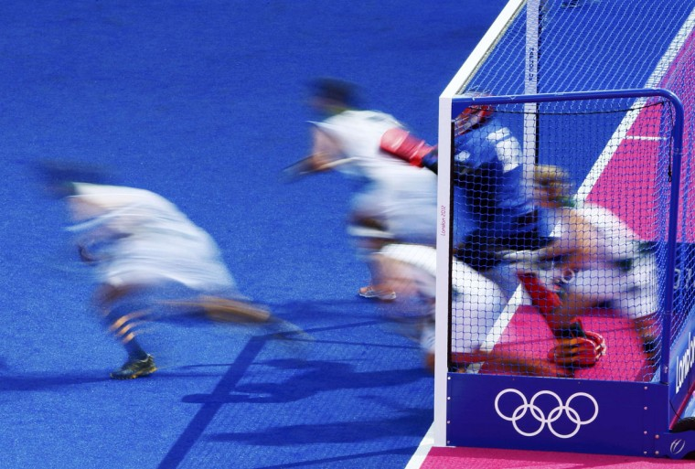South Africa's players defend a penalty corner during their men's Group A hockey match against Australia at the London 2012 Olympic Games at the Riverbank Arena on the Olympic Park in London July 30, 2012. (Kai Pfaffenbach/Reuters)
