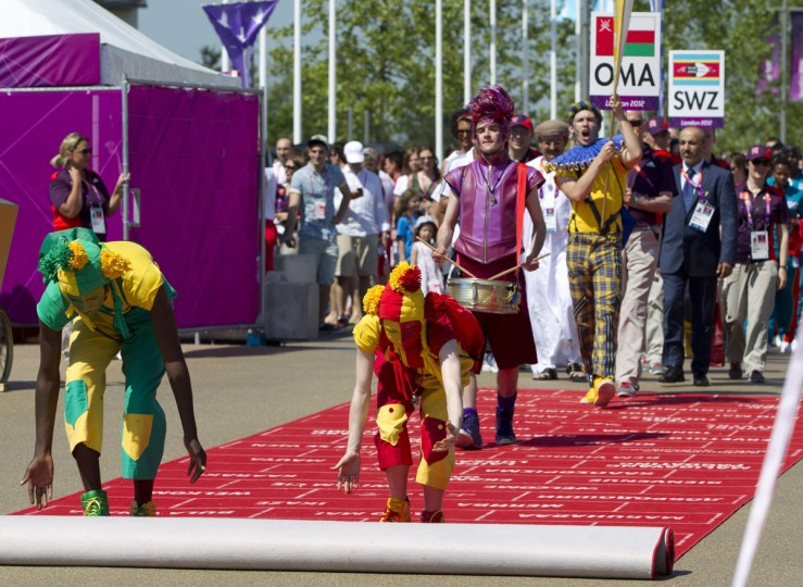 A red carpet is rolled out for representatives of Oman and Swaziland during a Welcoming Ceremony in the Olympic Village in London July 24, 2012. (Neil Hall/Reuters)