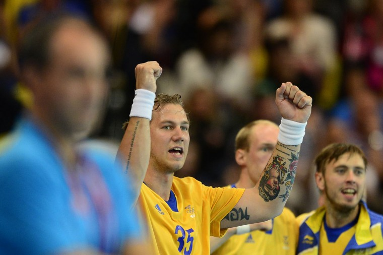Sweden's pivot Andreas Nilsson (L) reacts to a scoring during the men's preliminaries Group A handball match Sweden vs Tunisia for the London 2012 Olympics Games on July 29, 2012 at the Copper Box hall in London. (Javier Soriano/AFP/Getty Images)