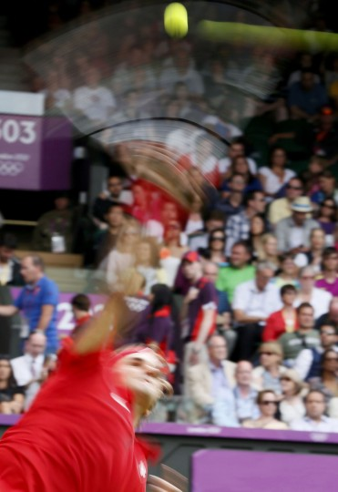 Switzerland's Roger Federer serves to Colombia's Alejandro Falla in their men's singles tennis match at the All England Lawn Tennis Club during the London 2012 Olympics Games July 28, 2012. (Stefan Wermuth/Reuters)