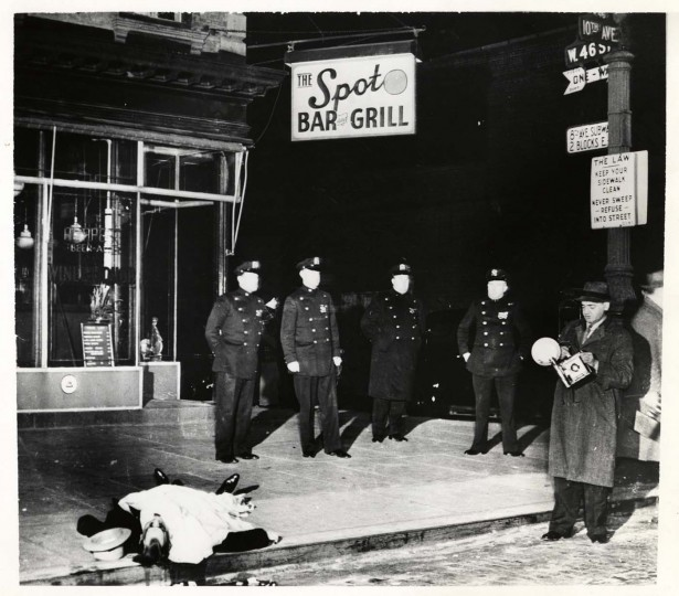 On the spot, December 9, 1939. Weegee standing at right with camera.Taken by unidentified photographer. (Courtesy: International Center of Photography)