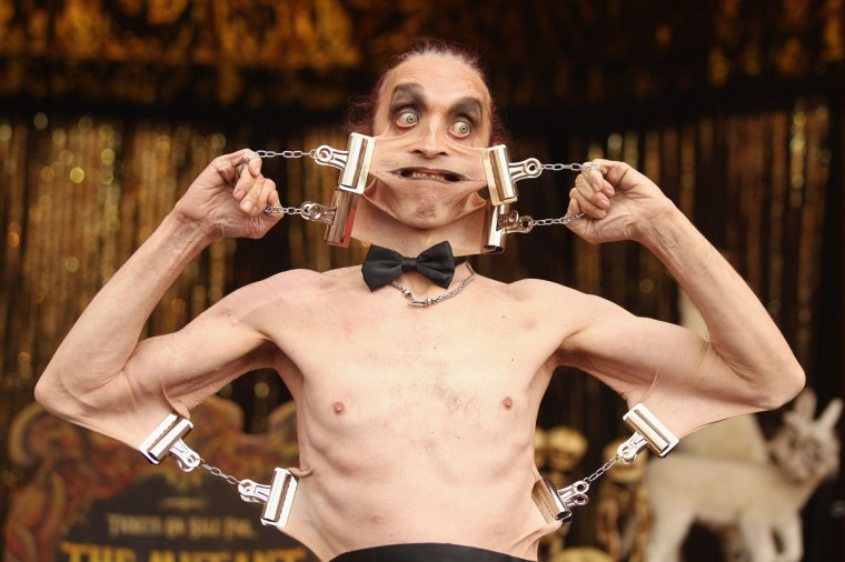 "Gary Stretch, who has the world's stretchiest skin, practices his routine in ""The Royal Family of Strange People"" at the Priceless London Wonderground at the Southbank Centre on July 19, 2012 in London, England. (Oli Scarff/Getty Images)"