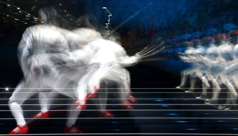 Valentina Vezzali of Italy competes against Arianna Errigo of Italy during their Women's Foil Individual Fencing Semi Final match on day one of the London 2012 Olympic Games at ExCeL on July 28, 2012 in London, England. (Alexander Hassenstein/Getty Images)