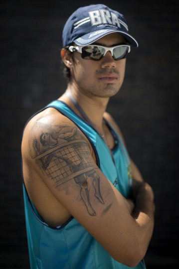 Brazil's Paulo Branco poses showing his beach volleyball inspired tattoo during a beach volleyball training session at the Brazil Olympic team's camp in Crystal Palace in London on July 23, 2012, four days before the start of the 2012 London Olympic Games. (Ben Stansall/AFP/Getty Images)