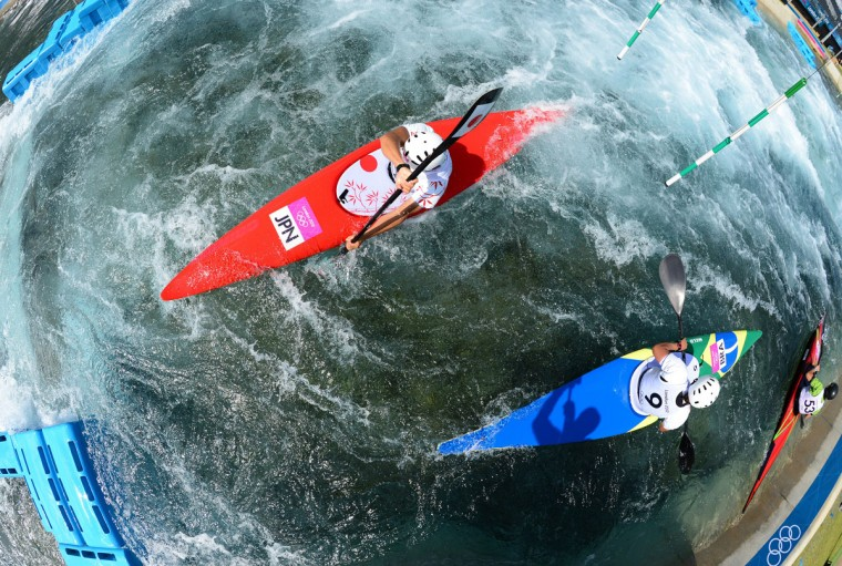 "Japan's Kazuki Yazawa (L) attends a men's Kayak Slalom training session at the 2012 London Olympic Games on July 28, 2012 at ""Lee Valley Water Park"" in London. (Oliver Morin/AFP/Getty Images)"