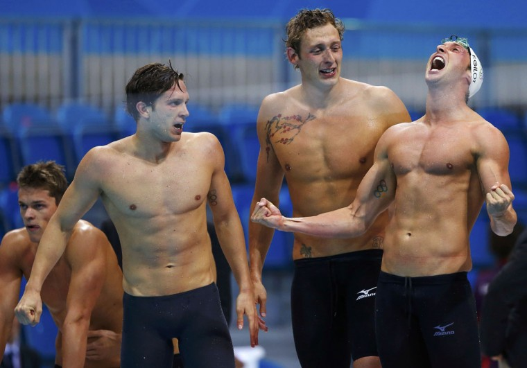 Members of France's 4x100m men's freestyle relay team Clement Lefert, Fabien Gilot and Amaury Leveaux cheer as their anchor Yannick Agnel swims to win the event final at the London 2012 Olympic Games at the Aquatics Centre July 29, 2012. France avenged their defeat to the United States in Beijing four years ago when they snatched the gold medal in the men's 4x100 metres freestyle final at the London Olympics on Sunday. (Jorge Silva/Reuters)