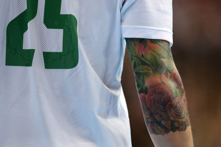 A tattoo on the right arm of Hungary's pivot Szabolcs Zubai is seen during the men's preliminaries Group B handball match South Korea vs Hungary for the London 2012 Olympics Games on July 31, 2012 at the Copper Box hall in London. (Javier Soriano/AFP/Getty Images)