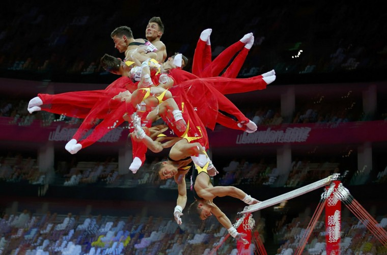 Philipp Boy of Germany competes in the horizontal bar event during the men's gymnastics qualification in the North Greenwich Arena during the London 2012 Olympic Games July 28, 2012. Picture taken with multiple exposures. (Mike Blake/Reuters)