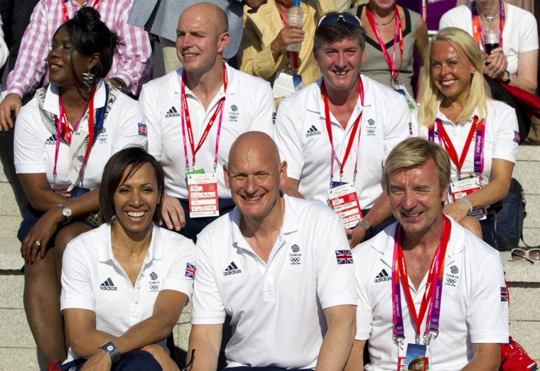 Olympic Medal winning British athletes, Top L-R: Tessa Sanderson, Adrian Moorhouse, Robin Cousins, Jayne Torvill; Bottom L-R: Kelly Holmes, Duncan Goodhew and Christopher Dean pose during a Welcoming Ceremony for Team GB in the Olympic Village in London July 24, 2012. (Neil Hall/Reuters)