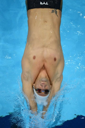 In a picture taken with a robotic camera France's Camille Lacourt competes in the men's 100m backstroke final swimming event at the London 2012 Olympic Games on July 30, 2012 in London. (Francois Xavier Marit/AFP/Getty Images)