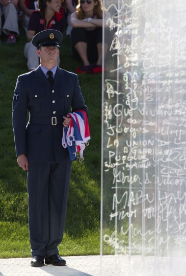 A member of the British Armed Forces holds a Union Flag by the Truce Wall during a Welcoming Ceremony for Team GB in the Olympic Village in London July 24, 2012. (Neil Hall/Reuters)