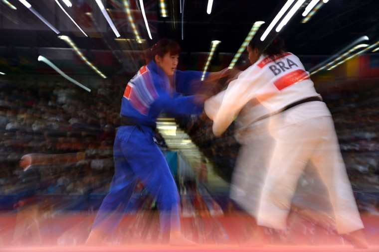 Brazil's Erika Miranda (white) competes with Korea's Kim Kyung-Ok (blue) during their women's -52kg contest match of the judo event at the London 2012 Olympic Games on July 29, 2012 ExCel arena in London. (Johannes Eisele/AFP/Getty Images)