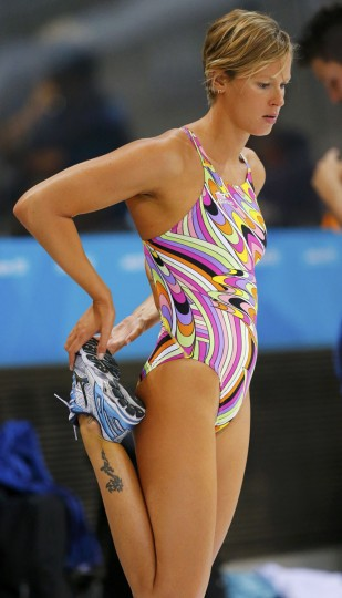 Italy's Federica Pellegrini stretches before training at the main pool at the Aquatics Centre before the start of the London 2012 Olympic Games in London July 26, 2012. (Jorge Silva/Reuters)