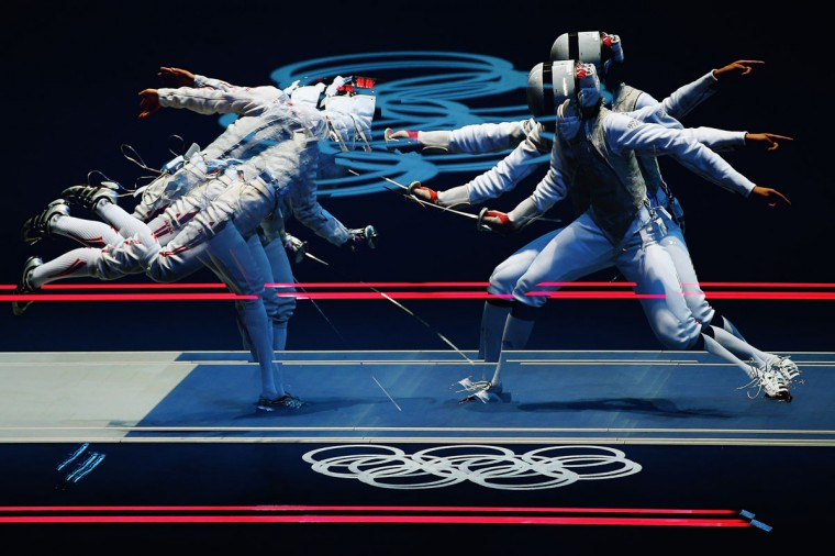 Carolin Golubytskyi of Germany competes against Elisa Di Francisca of Italy in their Women's Foil Individual Fencing round of 16 match on Day 1 of the London 2012 Olympic Games at ExCeL on July 28, 2012 in London, England. Multiple exposures were combined in camera to produce this image. (Hannah Johnston/Getty Images)