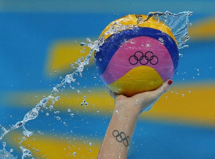 Gabriella's Szucs from the U.S controls the ball during their women's preliminary round Group A water polo match against Hungary at the Water Polo Arena at the London 2012 Olympic Games, July 30, 2012. (Laszlo Balogh/Reuters)