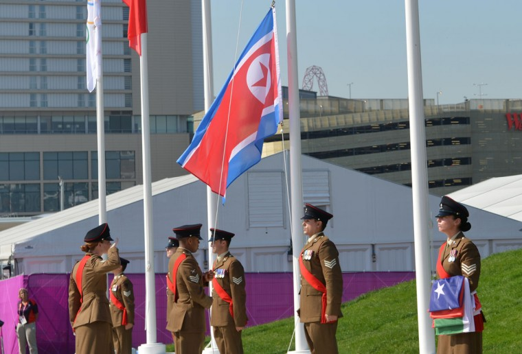 The North Korean flag is raised during a Welcome Ceremony for athletes at the Olympic Village in London on July 25, 2012, two days before the start of the London 2012 Olympic Games. (Adek Berry/AFP/Getty Images)