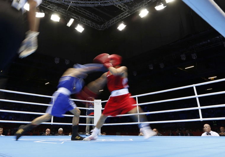 Kazakhstan's Kanat Abutalipov (R) fights against Syria's Wessam Slamana in the Men's Bantam (56kg) Round of 32 Bout 5 boxing match at ExCeL venue during the London 2012 Olympic Games July 28, 2012. (Murad Sezer/Reuters)