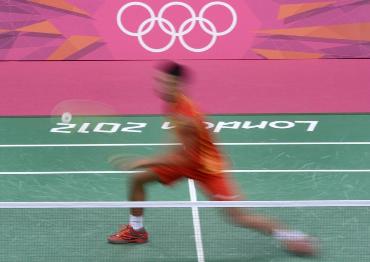 China's Lin Dan is pictured in action against Scott Evans of Ireland during their men's single badminton match at the London 2012 Olympic Games in London on July 30, 2012. Dan won 21-8, 21-14. (Manan Vatsyayana/AFP/Getty Images)
