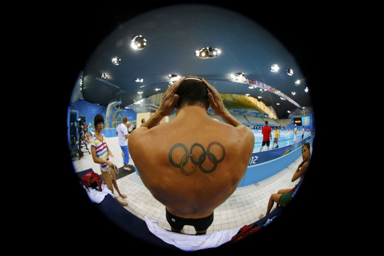 A tattoo of the Olympic rings is seen on Canada's Ryan Cochrane during a training session at the main pool of the Aquatics Centre before the start of the London 2012 Olympic Games in London July 26, 2012. (Jorge Silva/Reuters)