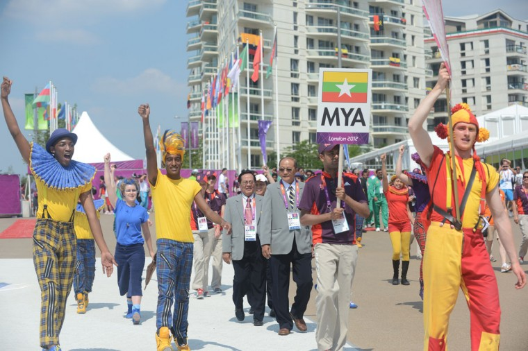 Officials and athletes from Myanmar march during the Flag Raising Ceremony at the Olympic village in London on July 25, 2012, two days before the start of the London 2012 Olympic Games. (Adek Berry/AFP/Getty Images)