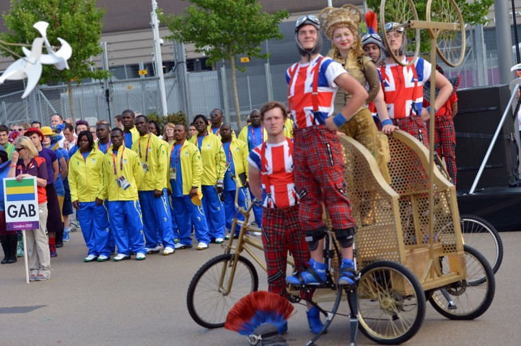 Athletes from Gambia attend a Flag Raising Ceremony at the Olympic village in London on July 25, 2012, two days before the start of the London 2012 Olympic Games.2012. (Saeed Khan/AFP/Getty Images)