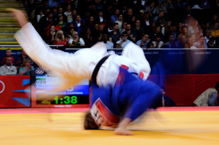 Austria's Ludwig Paischer (bottom) competes with Uzbekistan's Rishod Sobirov during their men's -60 kgs contest match of the judo event at the London 2012 Olympic Games on July 28, 2012 in London. (Franck Fife/AFP/Getty Images)