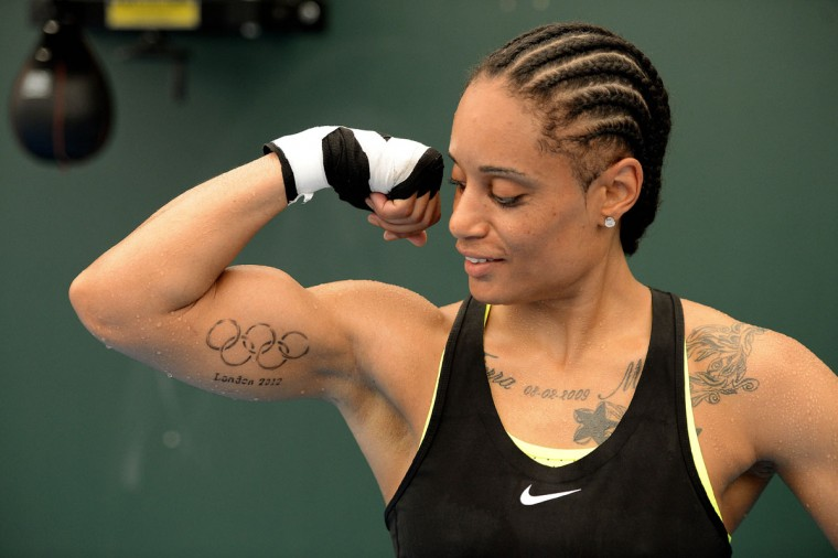 USA Women's lightweight Queen Underwood, from Seattle, WA, shows off her Olympic rings tattoo as she trains on a speed bag in preparation for the 2012 London Olympic Games at the SCORE training facility on July 26, 2012. (John David Mercer/USA TODAY Sports