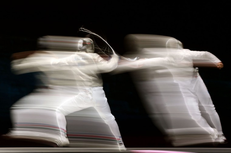 Aron Szilagyi (L) of Hungary competes against Nikolay Kovalev of Russia during their Men's Sabre Individual semifinal match on Day 2 of the London 2012 Olympic Games at ExCeL on July 29, 2012 in London, England. (Quinn Rooney/Getty Images)