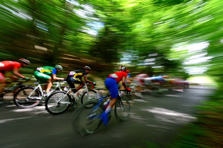 The peloton of riders race through Box Hill during the men's cycling race. (Mark J. Rebilas/USA TODAY Sports)