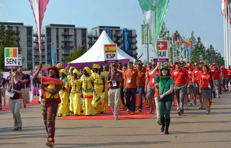 Olympic delegates from Switzerland (R), Spain (C) and Senegal (L) parade during the Flag Raising Ceremony at the Olympic village in London on July 25, 2012, two days before the start of the London 2012 Olympic Games. (Saeed Khan/AFP/Getty Images)