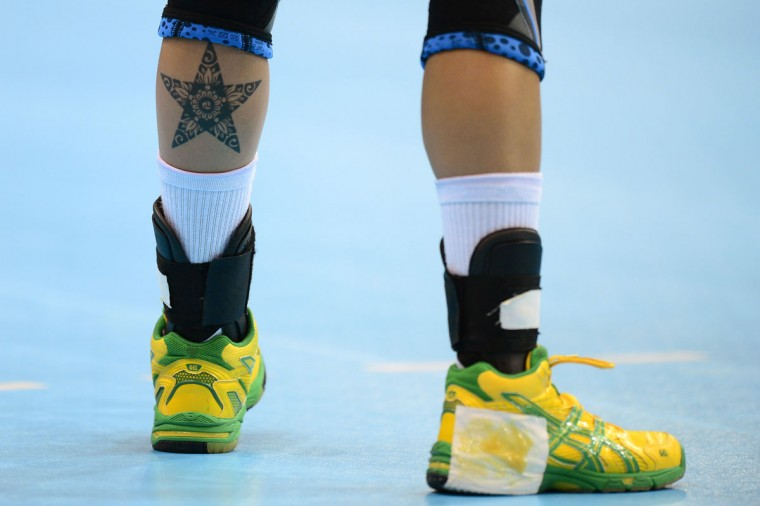 A star-shaped tattoo is seen on the left leg of Brazil's leftwing Fernanda Silva Rocha during the women's preliminaries Group A handball match Croatia vs Brazil for the London 2012 Olympics Games on July 28, 2012 at the Copper Box hall in London. Brazil won 24-23. (Javier Soriano/AFP/Getty Images)