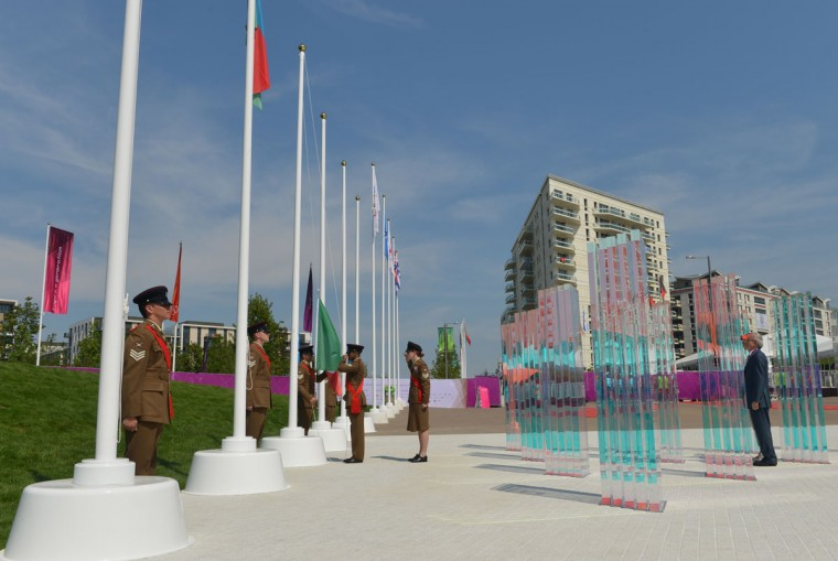 The Italian flag is raised during a Welcoming Ceremony for athletes at the Olympic Village in London on July 25, 2012, two days before the start of the London 2012 Olympic Games. (Adek Berry/AFP/Getty Images)