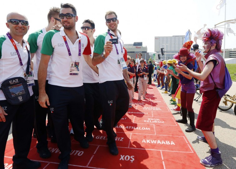 Team Italy athletes are cheered by dancers during a Welcoming Ceremony for the team in the Athletes Village at the Olympic Park ahead of the London 2012 Olympic Games July 25, 2012. (Luke MacGregor/Reuters)