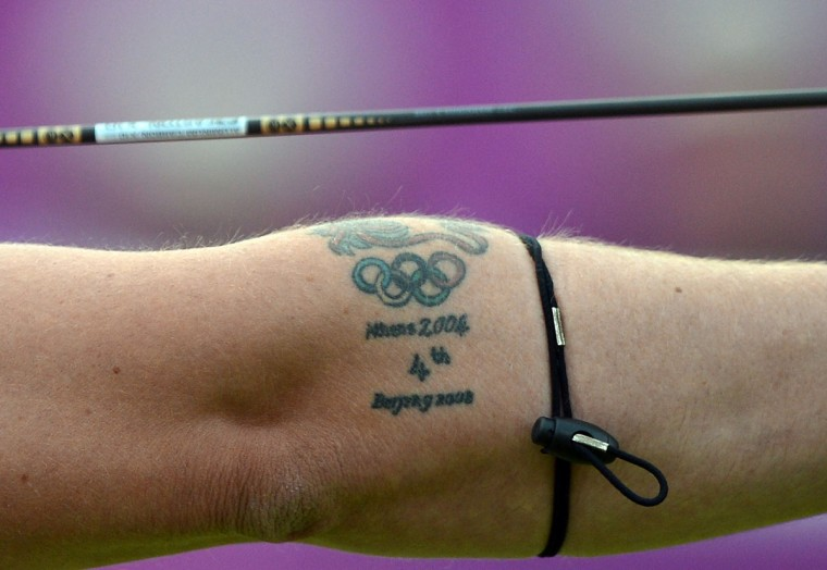 A tattoo on the arm of Larry Godfery of Great Britain is pictured as he competes against Juan Rene Serrano of Mexico during the archery men's individual elimination event on Day 3 of the London 2012 Olympic Games at Lord's Cricket Ground on July 30, 2012 in London. (Jewel Samad/AFP/Getty Images)