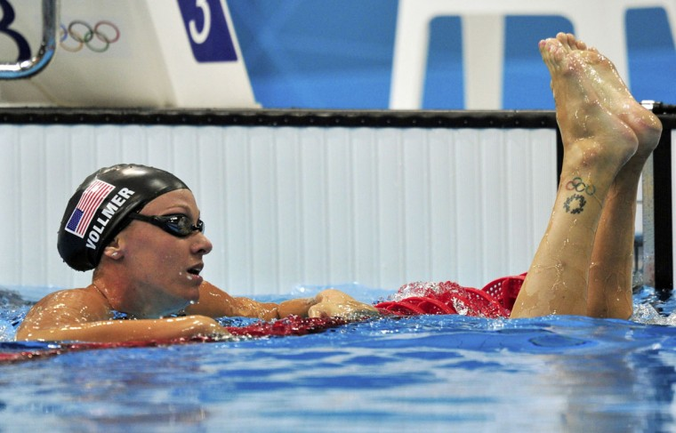 Dana Vollmer of the U.S. (L) follows her team mate Claire Donahue out of the pool after their women's 100m butterfly semi-final at the London 2012 Olympic Games at the Aquatics Centre July 28, 2012. (Toby Melville/Reuters)