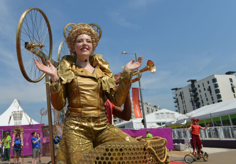 An artist performs during a Welcoming Ceremony for athletes at the Olympic Village in London on July 25, 2012, two days before the start of the London 2012 Olympic Games. (Adek Berry/AFP/Getty Images)