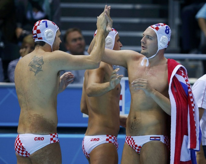 Croatia's Petar Muslim (L) celebrates with teammate Andro Buslje during their men's preliminary round Group A water polo match against Spain at the Water Polo Arena during the London 2012 Olympic Games July 31, 2012. (Laszlo Balogh/Reuters)
